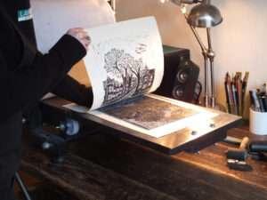 lino printing coming off the press