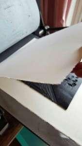 lino printing - placing the art paper